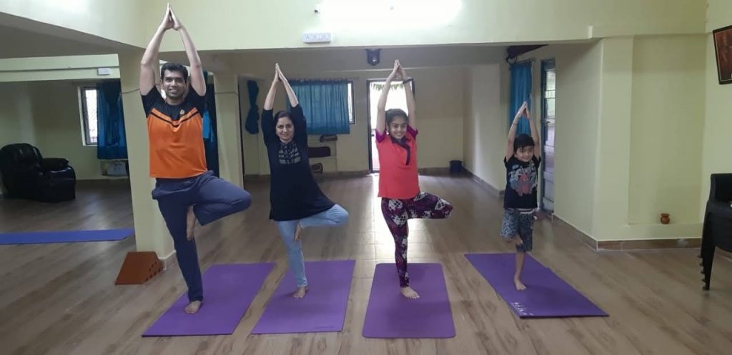 a family in the yoga center